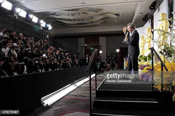 Director Paolo Sorrentino poses in the press room during the Oscars at Loews Hollywood Hotel on March 2 2014 in Hollywood California