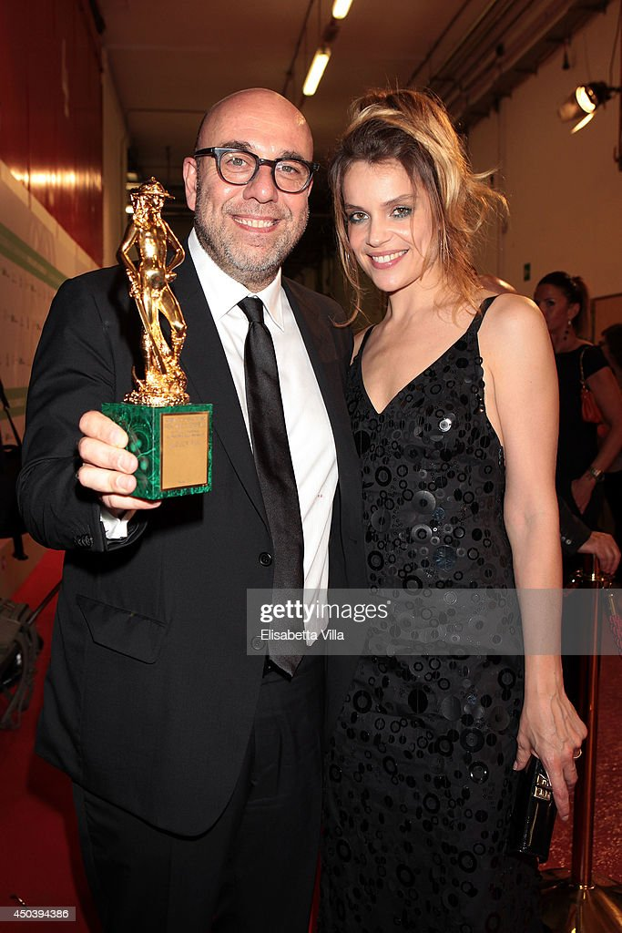 Director Paolo Virzi and Micaela Ramazzotti pose with the best film award for 'Il Capitale Umano' as he attends the David Di Donatello Awards Ceremony at the Dear Studios on June 10, 2014 in Rome, Italy.