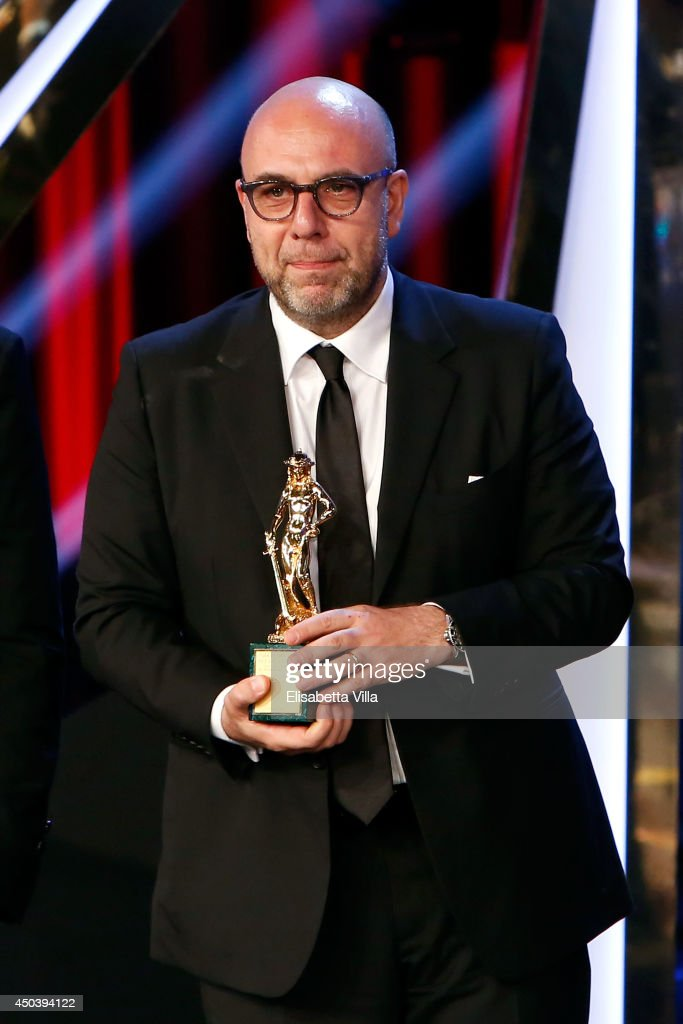 Director Paolo Virzi receives the best film award for 'Il Capitale Umano' as he attends the David Di Donatello Awards Ceremony at the Dear Studios on June 10, 2014 in Rome, Italy.