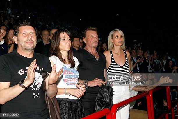 Director Pascal Duchene with companion Hortense d'Esteve Singer Johnny Hallyday and his wife Laeticia Hallyday in the stand while Patrick Bruel...