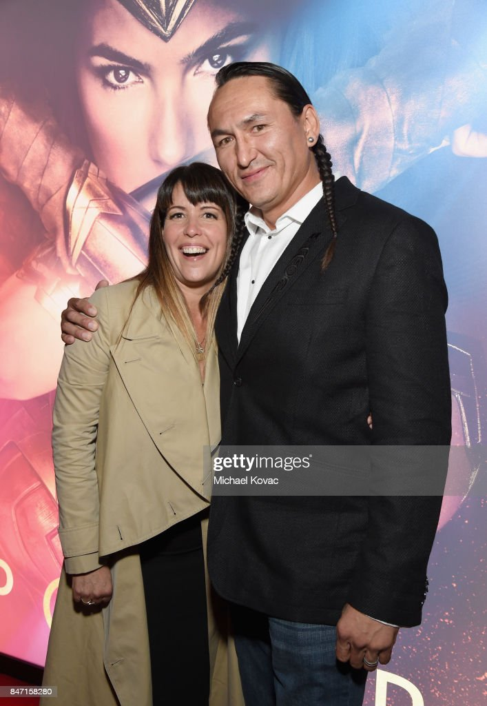 Director Patty Jenkins and actor Eugene Brave Rock attend the Warner Bros. Home Entertainment and Intel presentation of 'Wonder Woman in the Sky' at Dodger Stadium on September 14, 2017 in Los Angeles, California.