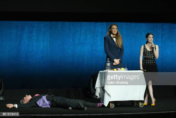 Director Paul Feig lays on the ground during a skit with actresses Blake Lively and Anna Kendrick during CinemaCon 2018 Lionsgate Invites You to An...
