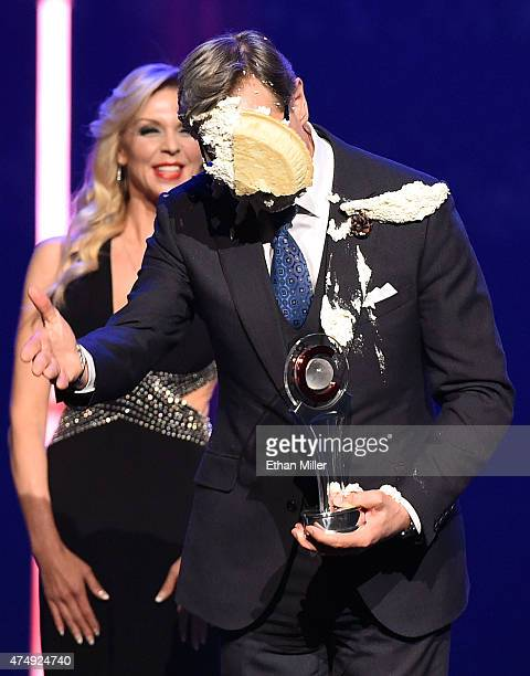 Director Paul Feig reacts after actor Bobby Cannavale hit him in the face with a pie after Feig accepted the Comedy Filmmaker of the Year Award...