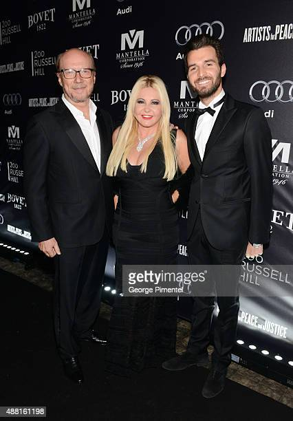 Director Paul Haggis and Cofounders of AMBI Pictures Andrea Iervolino and Monika Bacardi attend the Artists for Peace and Justice festival gala...
