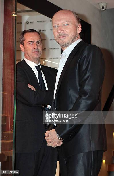 Director Paul Haggis and President of Vhernier Carlo Traglio attend the Artists For Peace And Justice Cocktail at Vhernier Boutique on December 2...