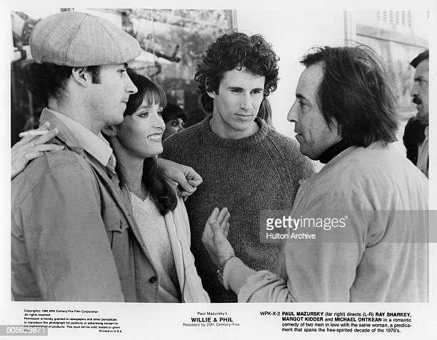 Director Paul Mazursky talks with Ray Sharkey Margot Kidder and Michael Ontkean in a scene from the 20th Century Fox movie Willie Phil circa 1980