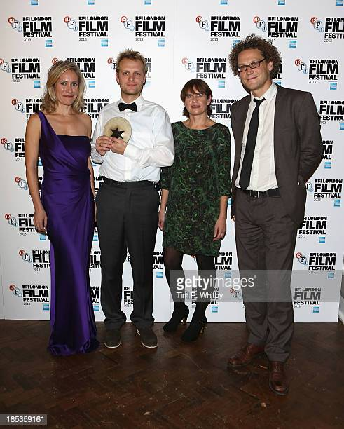 Director PaulJulien Robert winner of the Grierson award with wards presenter Sophie Raworth Jury President Kate Ogborn and Oliver Neuman at the BFI...