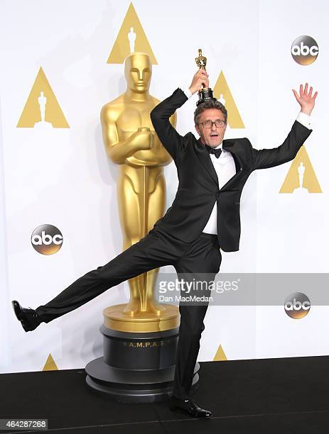 Director Pawel Pawlikowski poses in the press room with the award for Best Foreign Language Film at the 87th Annual Academy Awards at Hollywood...
