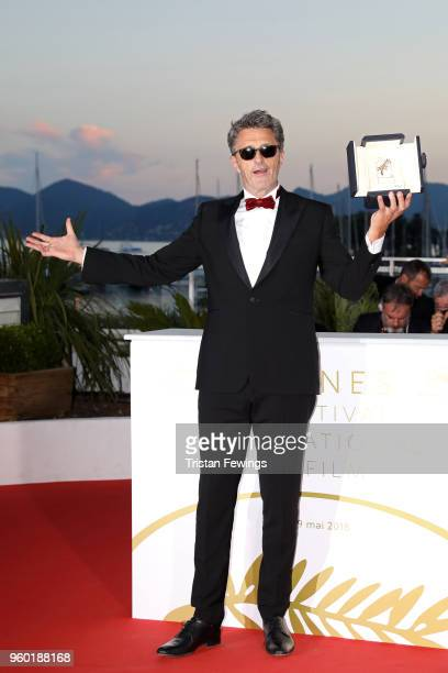 Director Pawel Pawlikowski poses with the Best Director award for 'Cold War' at the photocall the Palme D'Or Winner during the the 71st annual Cannes...