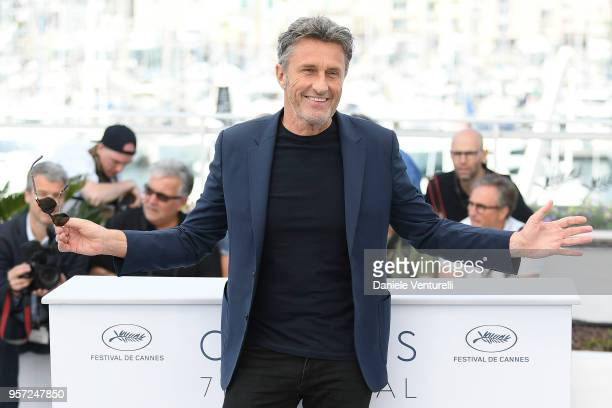 Director Pawel Pawlikowski wears a foot brace as he attends the photocall for Cold War during the 71st annual Cannes Film Festival at Palais des...