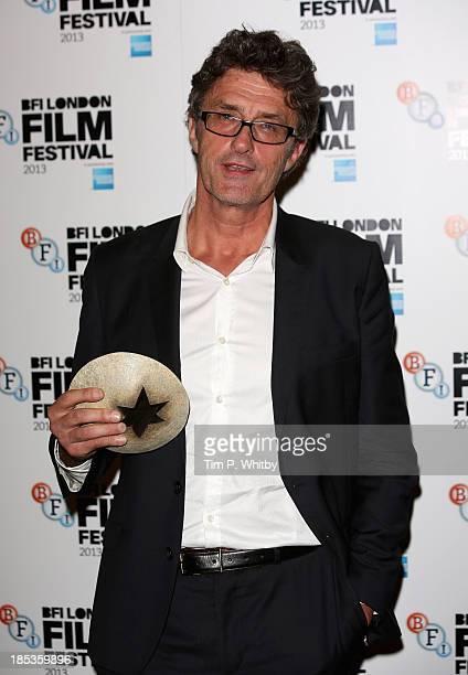 "Director Pawel Pawlikowski with his Best Film award for ""Ida"" at the BFI London Film Festival Awards during the 57th BFI London Film Festival at..."