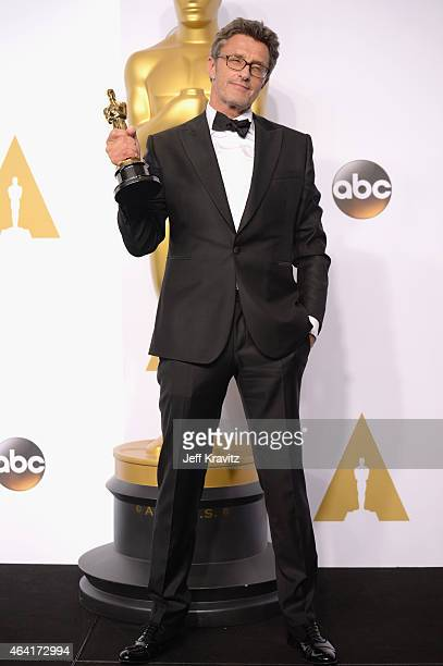 Director Pawel Pawlikowski with the award for best foreign language film for Ida poses in the press room during the 87th Annual Academy Awards at...