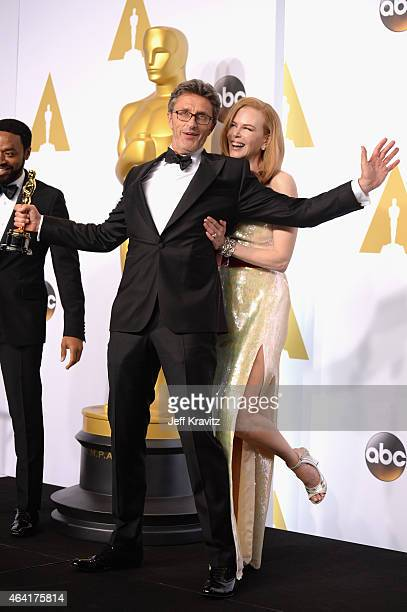 Director Pawel Pawlikowski with the award for best foreign language film for 'Ida' with actress Nicole Kidman pose in the press room during the 87th...