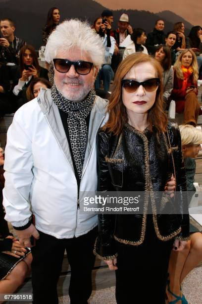 Director Pedro Almodovar and actress Isabelle Huppert attend the Chanel Cruise 2017/2018 Collection Show at Grand Palais on May 3 2017 in Paris France