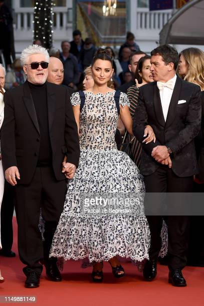 Director Pedro Almodovar Penelope Cruz wearing Atelier Swarovski Fine Jewelry and Antonio Banderas attend the screening of Pain And Glory during the...