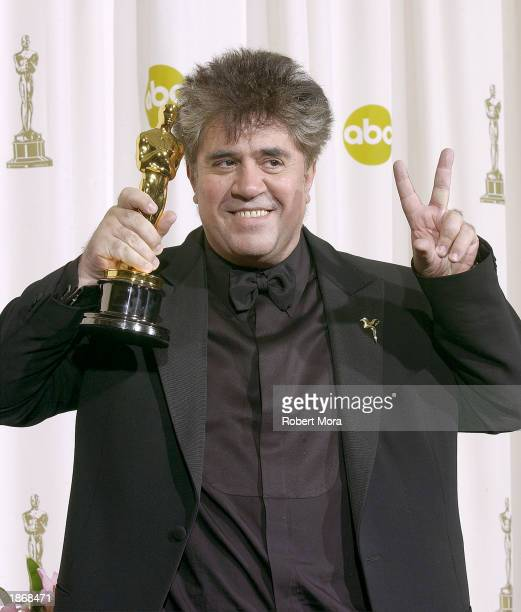 Director Pedro Almodovar poses with his Ocar for Best Original Screenplay for Talk To Her during the 75th Annual Academy Awards at the Kodak Theater...