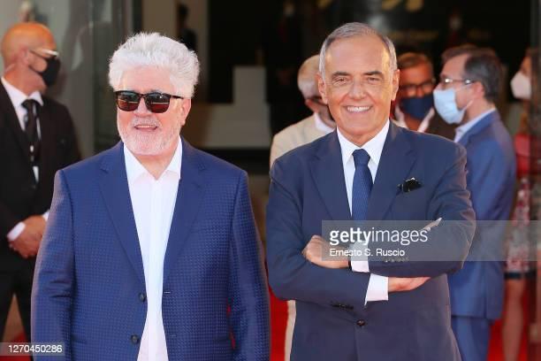 "Director Pedro Almodóvar and Director of 77 Mostra Internazionale d'Arte Cinematografica Alberto Barbera walk the red carpet ahead of the movie ""The..."