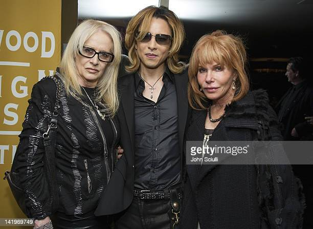 Director Penelope Spheeris musician Yoshiki and Kathy Melson attend the HFPA's Golden Globe Awards Theme Song Listening Party with Yoshiki on March...