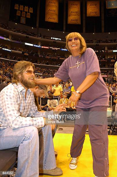 Director Penny Marshall talks with actor Brad Pitt at Game 1 of the NBA Finals between the Los Angeles Lakers and the New Jersey Nets June 5 2002 at...