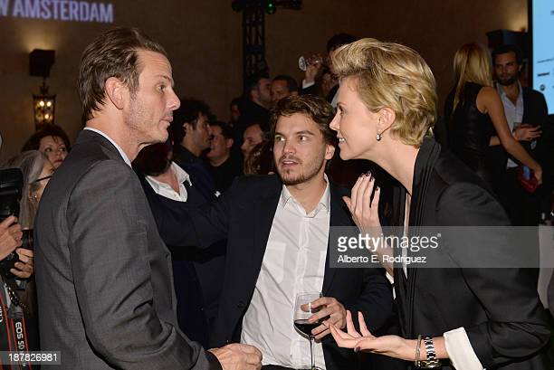 Director Peter Berg actor Emile Hirsch and actress Charlize Theron attend the premiere for 'Lone Survivor' after party during AFI FEST 2013 presented...
