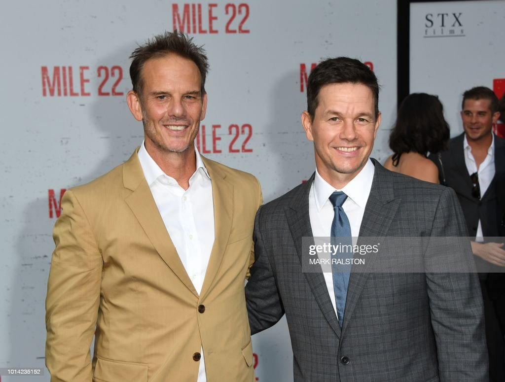 Director Peter Berg (L) and actor Mark Wahlberg (R) arrive for the premiere of STX Films' 'Mile 22' at the Westwood Village Theatre in Westwood, California on August 9, 2018.