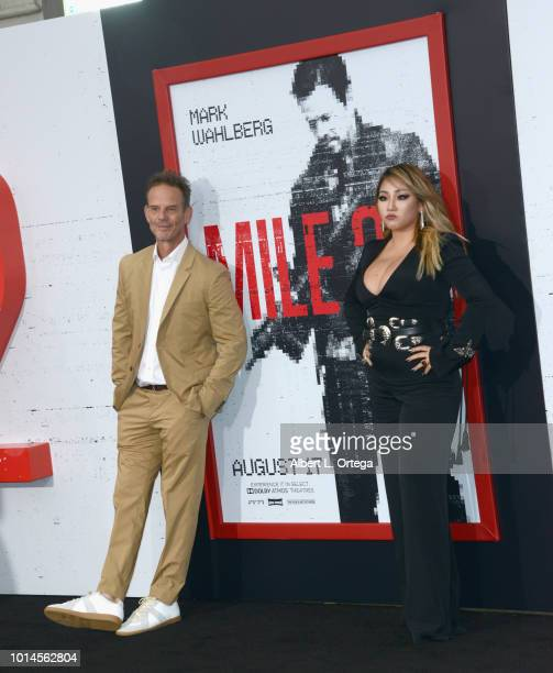 Director Peter Berg and CL arrive for the Premiere Of STX Films' 'Mile 22' held at Westwood Village Theatre on August 9 2018 in Westwood California