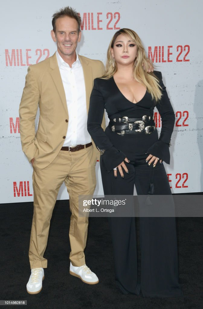 Director Peter Berg and CL arrive for the Premiere Of STX Films' 'Mile 22' held at Westwood Village Theatre on August 9, 2018 in Westwood, California.