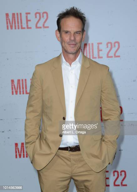 Director Peter Berg arrives for the Premiere Of STX Films' 'Mile 22' held at Westwood Village Theatre on August 9 2018 in Westwood California