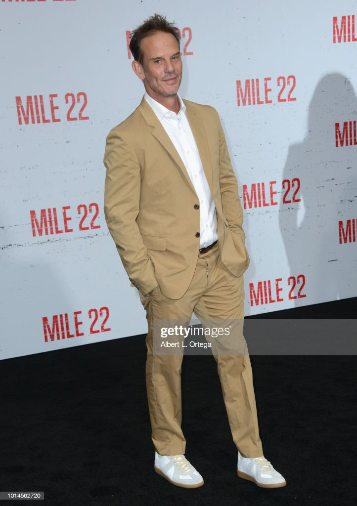 Director Peter Berg arrives for the Premiere Of STX Films' 'Mile 22' held at Westwood Village Theatre on August 9, 2018 in Westwood, California.
