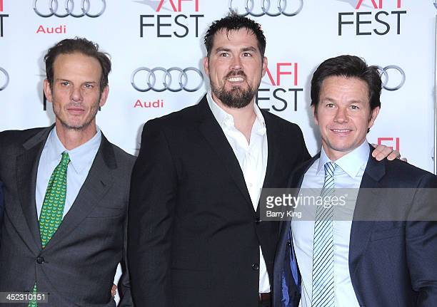 Director Peter Berg Former United States Navy SEAL Marcus Luttrell and actor Mark Wahlberg attend the screening of 'Lone Survivor' at AFI FEST 2013...