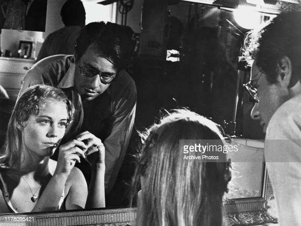 Director Peter Bogdanovich discusses a scene with actress Cybill Shepherd who is playing Jacy Farrow in his film 'The Last Picture Show' circa 1971