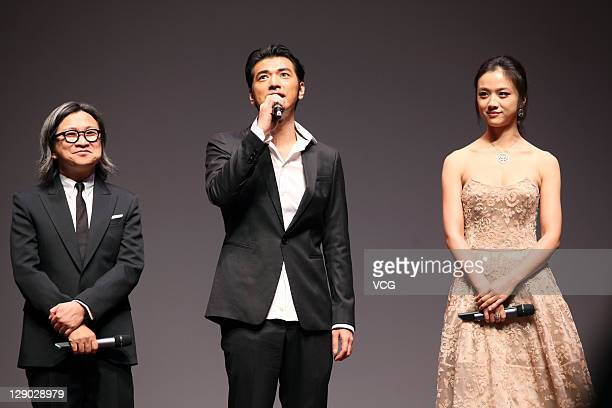 Director Peter Chan actor Takeshi Kanashiro and actress Tang Wei attend 'Wu Xia' premiere at Haneulyeon Theatre during the 16th Busan International...