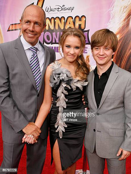 Director Peter Chelsom actress Emily Osment and actor Jason Earles arrive at the premiere of Walt Disney Picture's Hannah Montana The Movie held at...