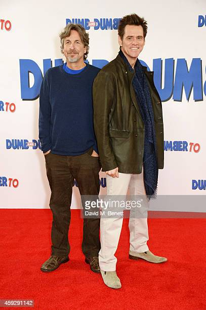 Director Peter Farrelly and actor Jim Carrey attend a photocall for Dumb and Dumber To on November 20 2014 in London England