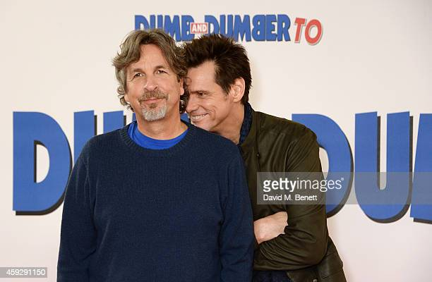 Director Peter Farrelly and actor Jim Carrey attend a photocall for 'Dumb and Dumber To' on November 20 2014 in London England
