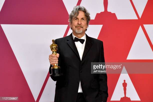 """Director Peter Farrelly poses with the Best Picture and Best Original Screenplay award for """"Green Book"""" in the press room during at Hollywood and..."""