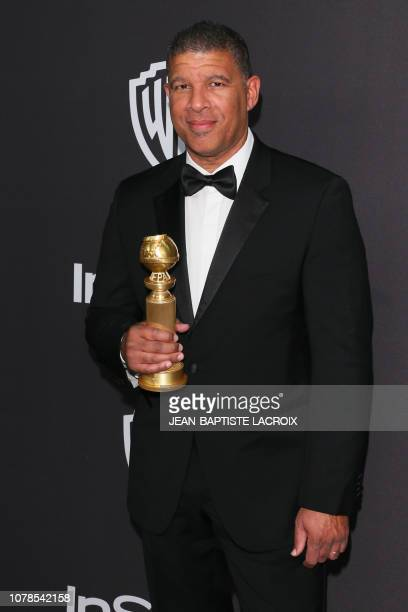 US director Peter Ramsey poses with the Golden Globe for Best Motion Picture Animated for SpiderMan Into the SpiderVerse as he arrives for the Warner...