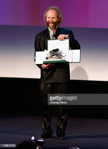 Director Philip Groning poses on stage with the Special Jury Prize Award he received for his movie 'Die Frau Des Polizisten' as he attends the...