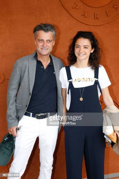 Director Philippe Dajoux and actress Pauline Bression attend the 2018 French Open Day One at Roland Garros on May 27 2018 in Paris France