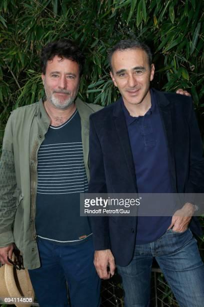 Director Philippe de Chauveron and humorist Elie Semoun attend the 2017 French Tennis Open Day Thirteen at Roland Garros on June 9 2017 in Paris...