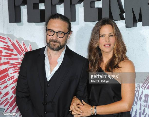 Director Pierre Morel and actress Jennifer Garner arrive for the Premiere Of STX Entertainment's Peppermint held at Stadium 14 on August 28 2018 in...