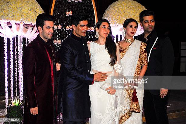 Director Punit Malhotra and fashion designer Manish Malhotra with guests and Bollywood actresses Karishma Kapoor Urmila Matondkar and filmmaker Karan...