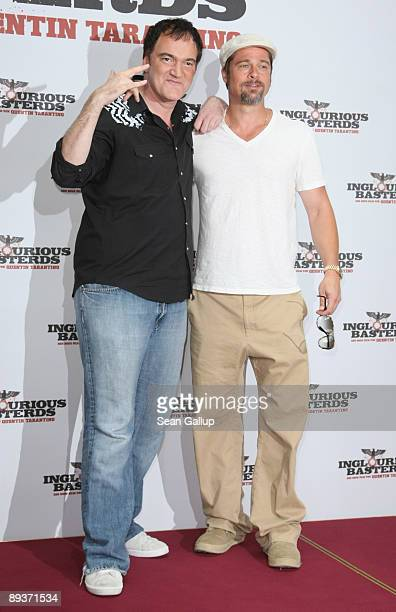Director Quentin Tarantino and actor Brad Pitt attend the photocall for Inglourious Basterds at the Adlon Hotel on July 28 2009 in Berlin Germany