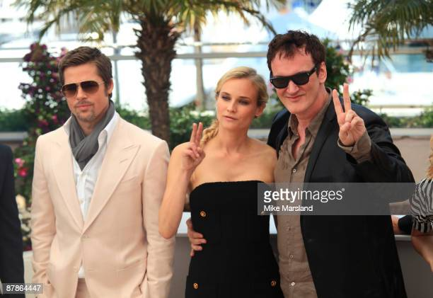 Director Quentin Tarantino and actors Brad Pitt and Diane Kruger attend the Inglourious Basterds Photocall held at the Palais Des Festivals during...