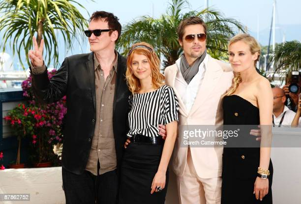 Director Quentin Tarantino and actors Melanie Laurent Brad Pitt and Diane Kruger attend the Inglourious Basterds Photocall held at the Palais Des...