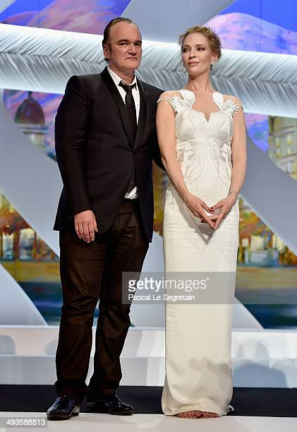 Director Quentin Tarantino and actress Uma Thurman appear on stage to give the Palme d'Or award during the Closing Ceremony at the 67th Annual Cannes...