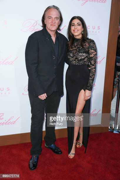 Director Quentin Tarantino and Daniella Pick attends the premiere of Focus Features' The Beguiled at Directors Guild Of America on June 12 2017 in...