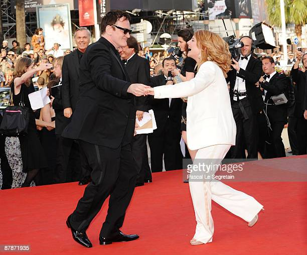 Director Quentin Tarantino dances with actress Melanie Laurent at the Inglourious Basterds Premiere held at the Palais Des Festivals during the 62nd...