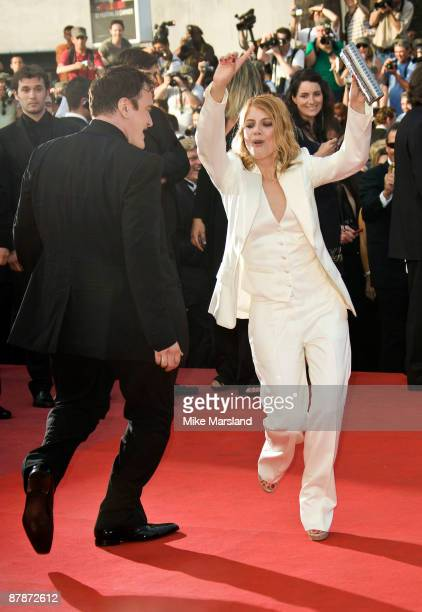Director Quentin Tarantino dances with actress Melanie Laurent at the 'Inglourious Basterds' premiere at the Grand Theatre Lumiere during the 62nd...