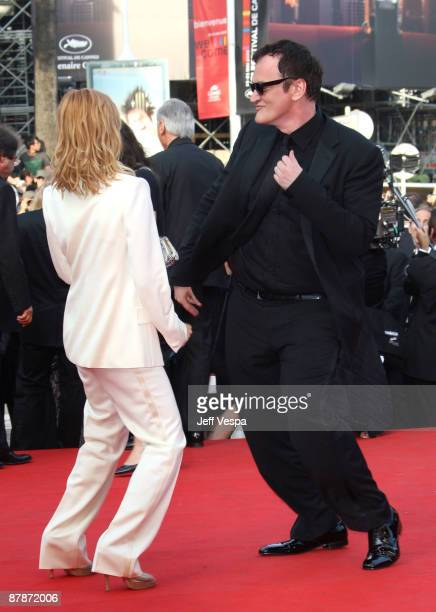 Director Quentin Tarantino dances with actress Melanie Laurent attend the 'Inglourious Basterds' Premiere at the Grand Theatre Lumiere during the...